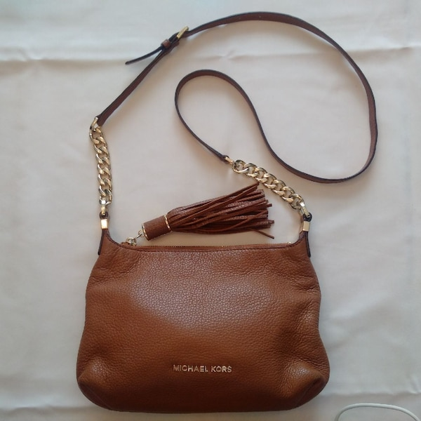 c387c3eadb1340 Used brown Michael Kors leather crossbody bag for sale in Saint-Georges-de -Clarenceville