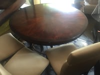 round brown wooden table with chairs Burlington, L7R 1T2