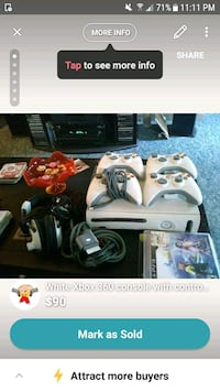 white Xbox 360 console with controller and game cases screenshot Mishawaka, 46544