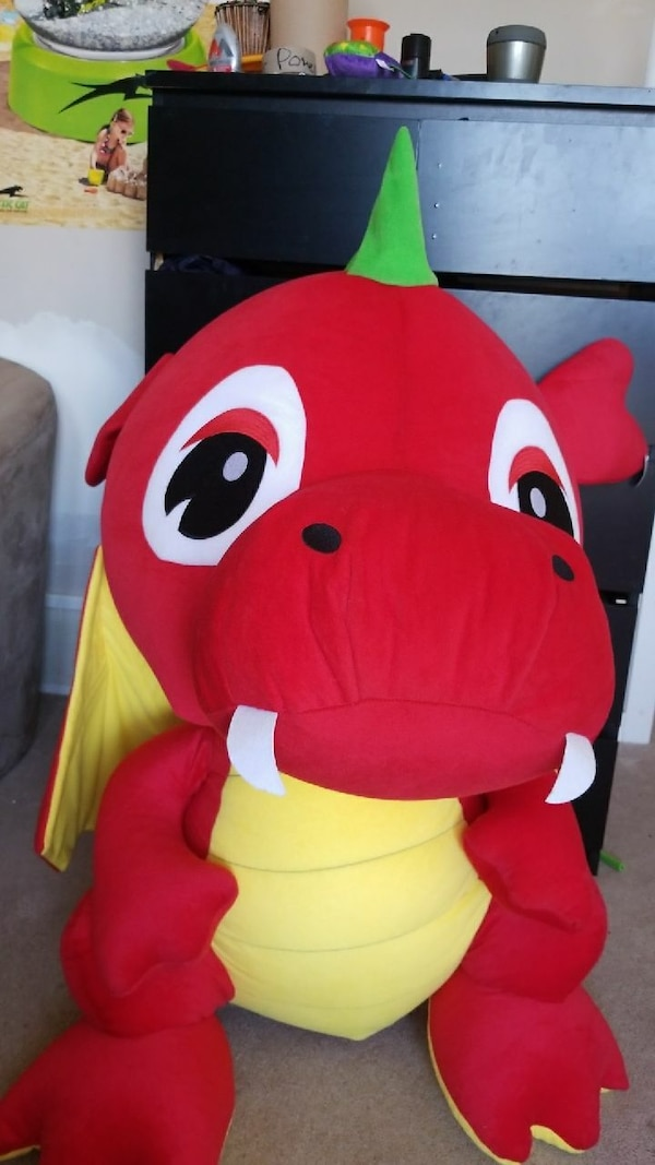 red and yellow dragon plush toy