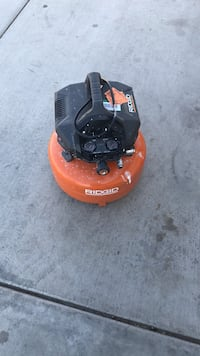 black and red Porter Cable air compressor 2224 mi