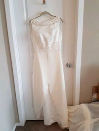 Wedding dress, size 8. Includes shawl and gloves. Calgary, T2X 2H6