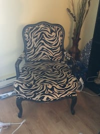 Colonial style arm chair, Zebra Black/Tan,colonial style arm chair with solid wood frame  pillow can move and wash, measures 28 inch  wide at the arms,,clean, smoke free . bought at Winners store.