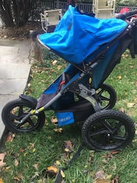 Baby's blue and black jogging stroller
