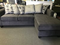 gray fabric sectional sofa with throw pillows 335 mi