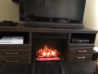 black flat screen TV with brown wooden TV stand Longueuil, J4H