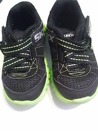 black-and-green Skechers velcro-strap shoes
