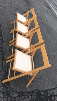 4 solid wood folding chairs like new