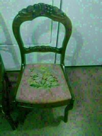 brown wooden framed green padded armchair