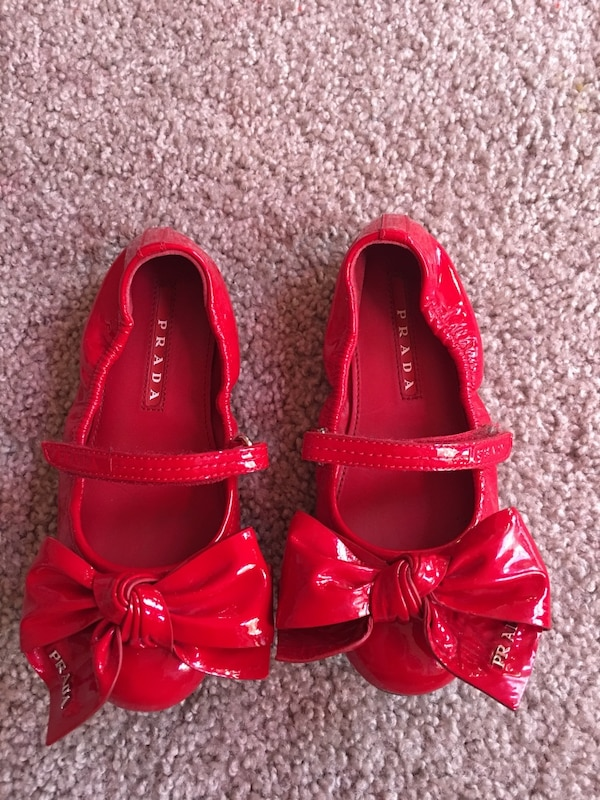 Girl's pair of red leather prada shoes