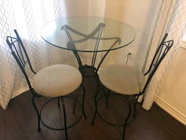 Glass table with two chairs