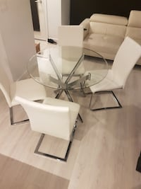 Glass table. CHAIRS ARE SOLD