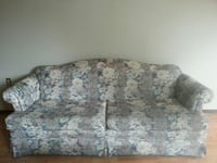 beige and black floral 2-seat sofa