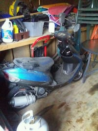 blue and black motor scooter