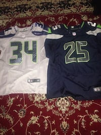two white 34 and blue 25 NFL jersey shirts Bellevue