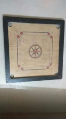 Carrom board with strikers