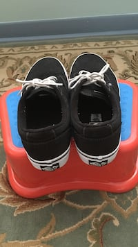 Pair of black-and-white vans low-top shoes