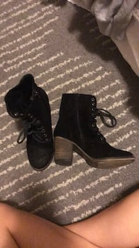 pair of black suede chunky heeled booties