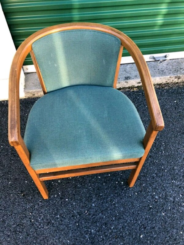 brown wooden framed blue padded armchair