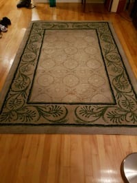 Beige and green carpet 5x7