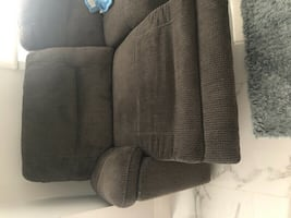 Large grey sectional couch with recliners, cup holder and 5 seater