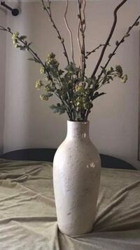 Large beige ceramic vase with artificial flowers