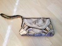 Small champagne Juicy Couture wristlet