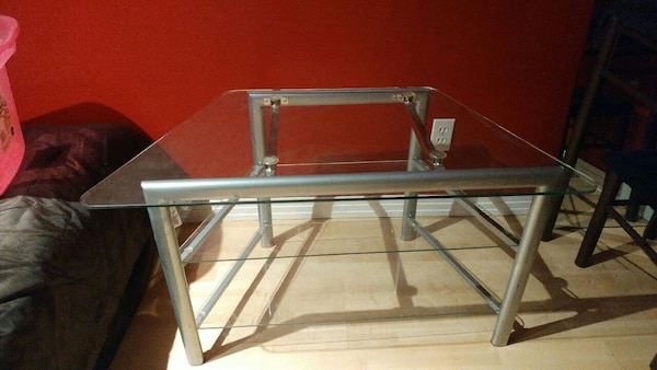 Glass 3 tier tv table. Paid $100 for it