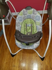 baby's gray and green swing chair