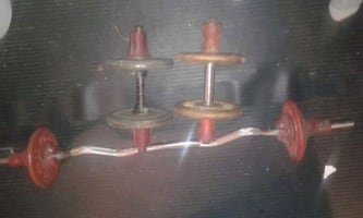 two stainless steel candle holders