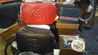 two rectangular red and black Gucci leather long wallets