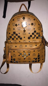 brown and black MCM leather stud backpack