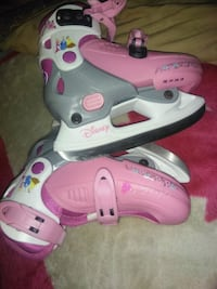 pair of pink-and-white inline skates Calgary, T3J 3N3