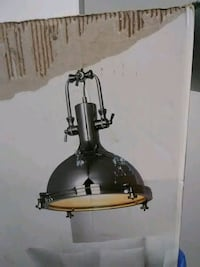 Beautiful Chrome finished lamp with glass shade.