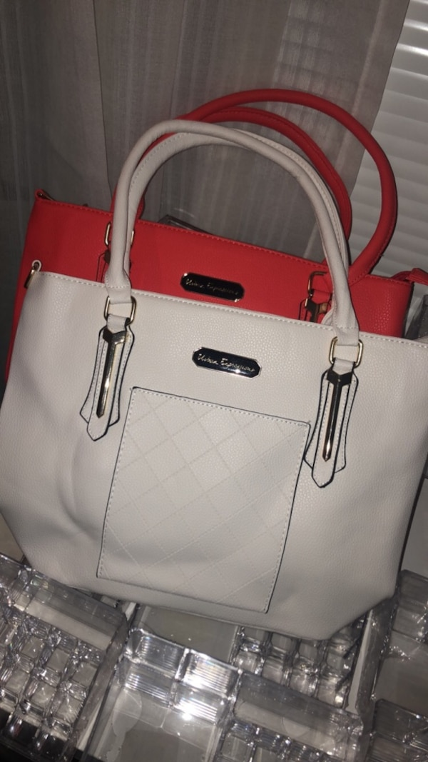 two quilted white and red leather tote bags