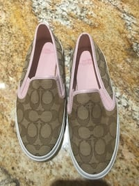 Brand new, size 5 Coach slip ons