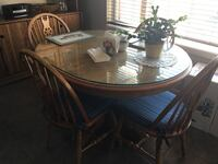 Round brown wooden table with four chairs dining set Calgary, T3M