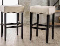 two white padded bar stools VANCOUVER