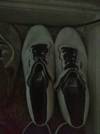 pair of gray-and-black Nike running shoes Houston, 77040