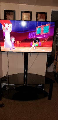 black flat screen TV with black TV stand BOISE