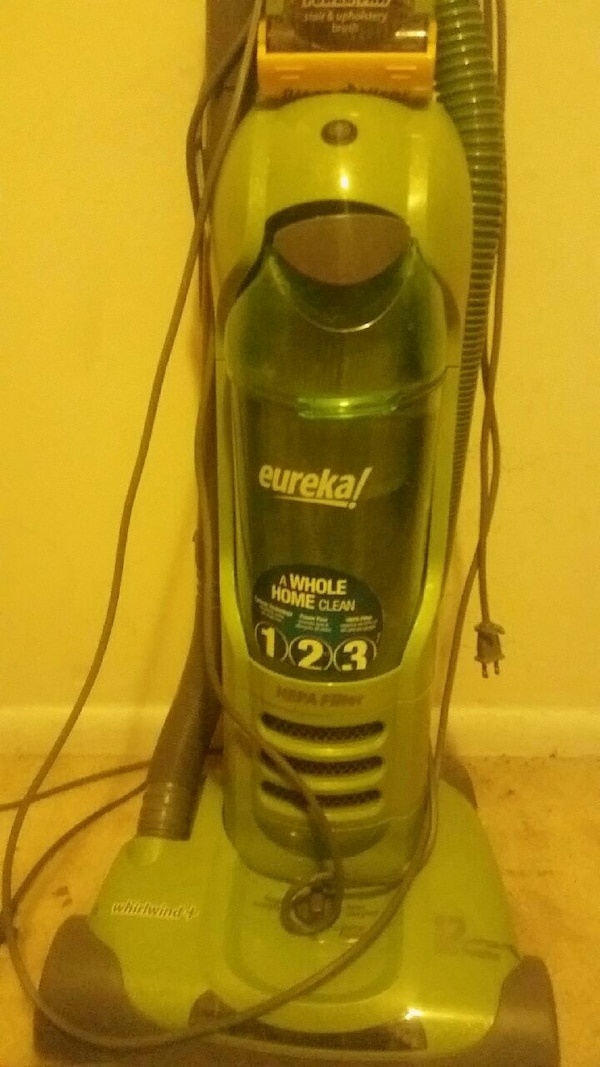 blue and gray Eureka upright vacuum cleaner