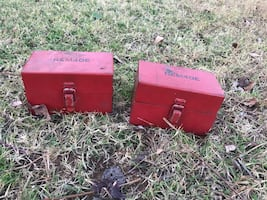 Two red rem40e metal chest boxes