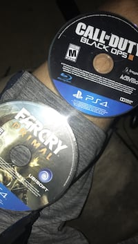 two Sony PS4 game discs