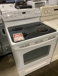 ❥Used white glass top GE electric stove- Seaford