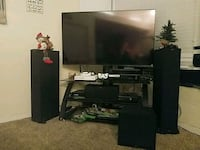 flat screen TV and black wooden TV stand Bakersfield, 93309