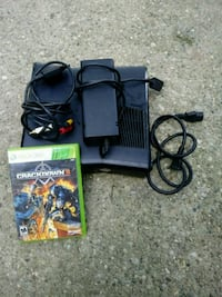 black Xbox 360 console with controller and game cases Indianapolis, 46222