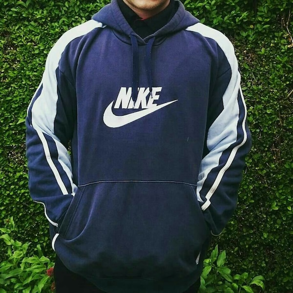 4177c59acd07 Used men s blue and white Nike pull over hooded jacket for sale in Derby -  letgo