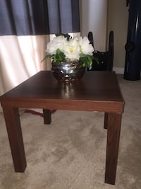 brown wooden side table with white petaled flowers Centreville, 20121
