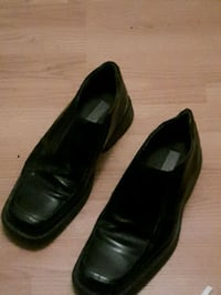 pair of black leather dress shoes Calgary, T2A 4T7