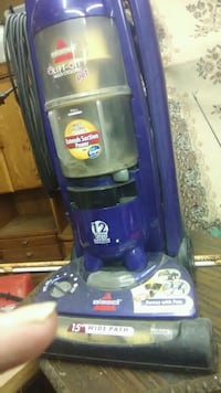 blue and black Bissell upright vacuum cleaner 611 mi